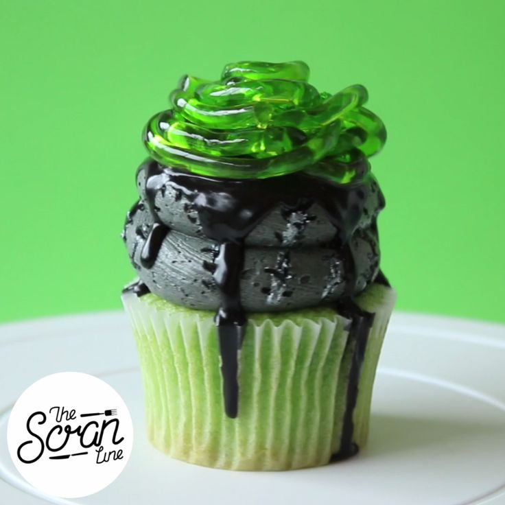 Green velvet cupcakes, black choc sauce, swirl of zombie frosting and jelly brain worms.