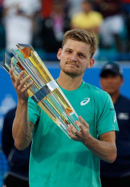 David Goffin Photos Photos - Runner up  David Goffin of Belgium poses with his trophy after the Final match of the Mubadala World Tennis Championship at Zayed Sport City  on December 31, 2016 in Abu Dhabi, United Arab Emirates. - Mubadala World Tennis Championship - Day Three