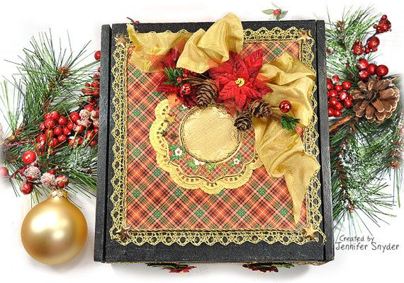 This is a hand decorated wooden cigar box for the Christmas Holidays. Its sized 8in x7.5in and in 3.5in tall. It was made from Graphic 45 scrapbook paper, and gorgeous Petaloo flowers. The accent colors are gold, red and green. The base color of the wood box is black - so the rich plaid