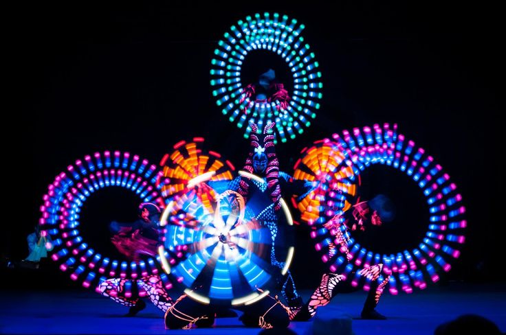 Blacklight Show  Cosmic creatures with luminous tools show the dance of future in almost absolute darkness, which lets their UV-reflective costumes and masks come up.