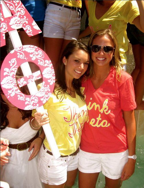 """Bright color shirts, compass on the front or just """"Theta Phi Alpha,"""" white shorts, and the letter signs"""