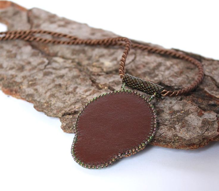 bead embroidered pendant with old button and karneol/ back - natural leather