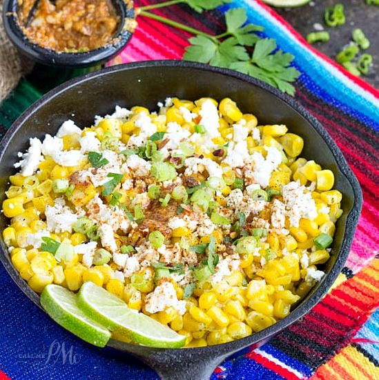 Skillet Mexican Street Corn Recipe is the best corn you will eat, it's served Mexican style smothered with a creamy spread, feta, and spices.