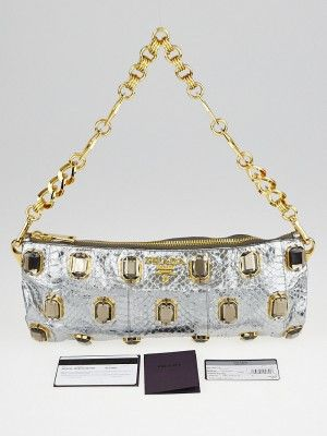 Searching for the perfect evening bag? This stunning Prada silver python jeweled clutch will be your go-to Pochette. Featuring rare and unusual python, this chain clutch bag slips elegantly under your arm with its chain link strap, so that you can sip your wine and text your friends at time! Retail  price $1595.