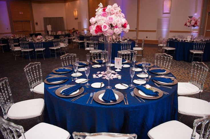Ballroom wedding reception ideas for summer: navy blue tablecloths and tall pink centerpieces (Naomi Lynn Photography)