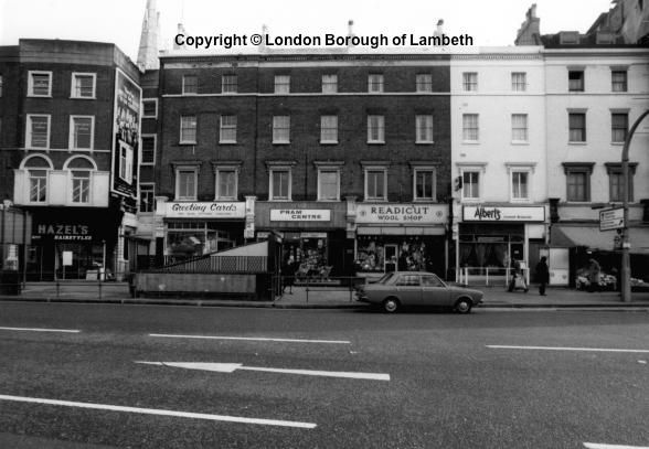 Date : c.1970  Shops at Nos 6-11 Clapham Common South Side include a hairdressers, pram shop and wool suppliers.