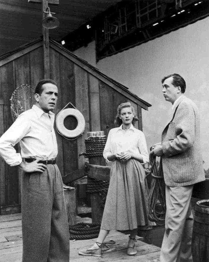 "Humphrey Bogart as Frank McCloud, Lauren Bacall as Nora Temple and director John Huston - behind the scenes - ""Key Largo"" - 1948"