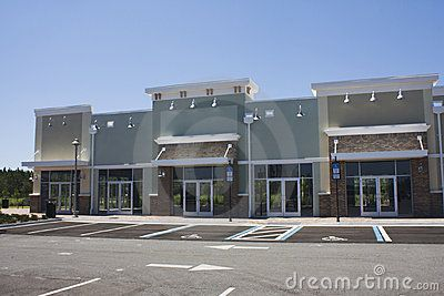 Pastel strip mall with stucco and traditional brick for Modern retail building design