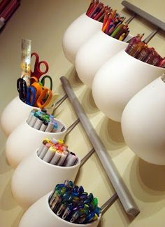 Ikea storage pods craft-room-decor...towel bar or rail above desk space with hooks for hanging scissors, tape, and Asker Cups from Ikea that can hold pens, pencils and more.