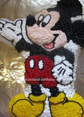 Homemade  Mickey Mouse Birthday Cake: I ordered the Wilton cake pan off eBay and made this Mickey Mouse Birthday Cake for my daughters first birthday.  This was everyones cake.    I made