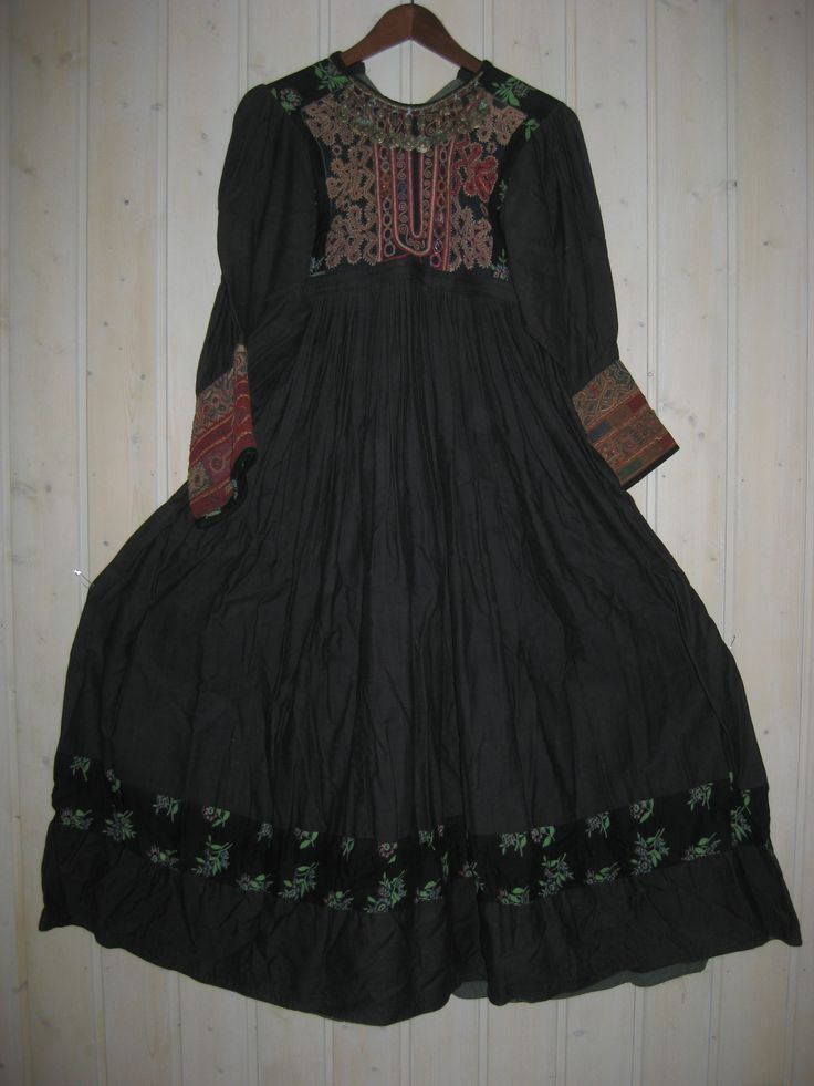 The Koochi dresses, brought back to the West, are those that identified Afghanistan in the 1970s hippie era. This dress is a mixture of old pashtun embroideries and black/ printed (russian) cotton. Made in Norway in the 70th.