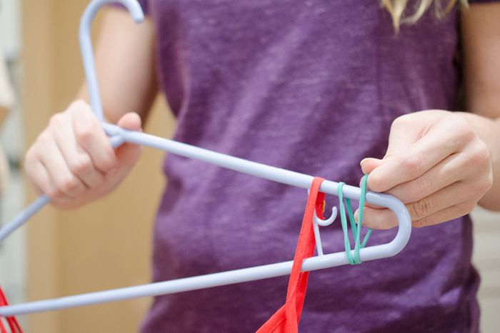 Keep clothes from slipping off their hangers with a rubber band