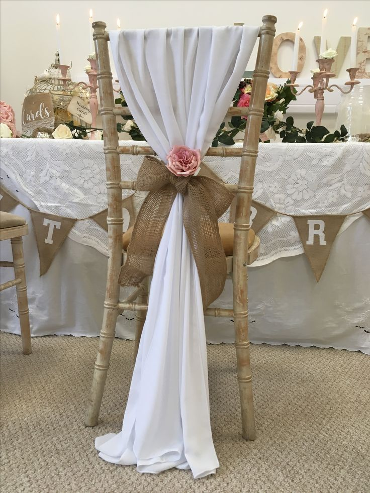 Chiffon drape Forget me not chair hire .