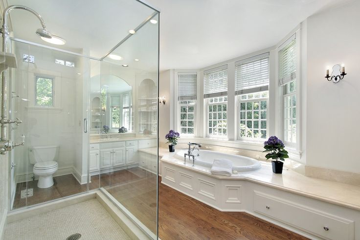 White master bathroom with glass shower enclosure and wooden floor. 50 Magnificent Luxury Master Bathroom Ideas ➤To see more Luxury Bathroom ideas visit us at www.luxurybathrooms.eu #luxurybathrooms #homedecorideas #bathroomideas @BathroomsLuxury