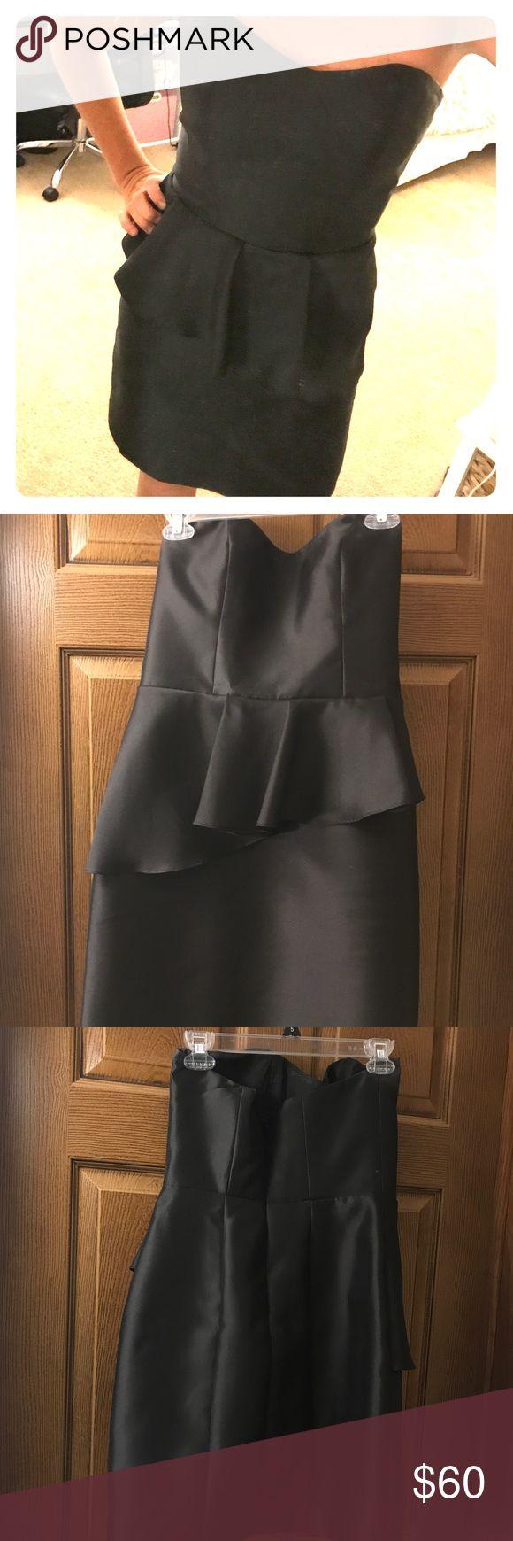 Dressy black peplum dress. Bridesmaid dress. EUC Super chic black cocktail dress with peplum around waist. Worn once. No stains or flaws. Dresses Wedding
