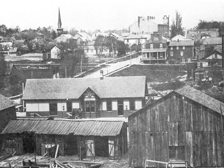 View from Brant Hill of the railroad station, with the Norfolk Hotel behind and the spire of St. Paul's Anglican Church on top left. Circa, 1908.
