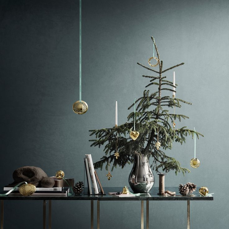 Get the Scandi Christmas Look: Candles on Christmas Trees. Georg Jensen have these lovely candle holders that sit safely on your christmas tree. (promotion)
