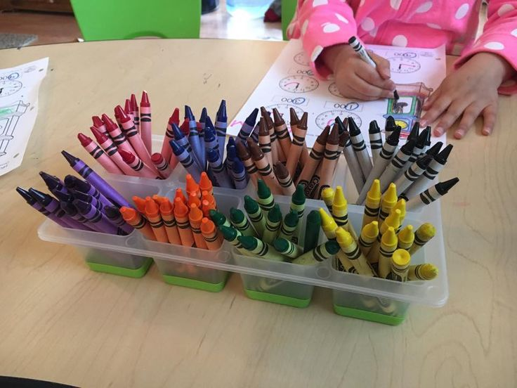 An inexpensive ice cube tray used as crayon storage. Beautiful and practical idea thanks to There's No Place Like Home Daycare!