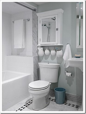 Bathroom floor - Love the way Sarah Richardson combines cheap floor tiles with more expensive to create a unique and upscale look.