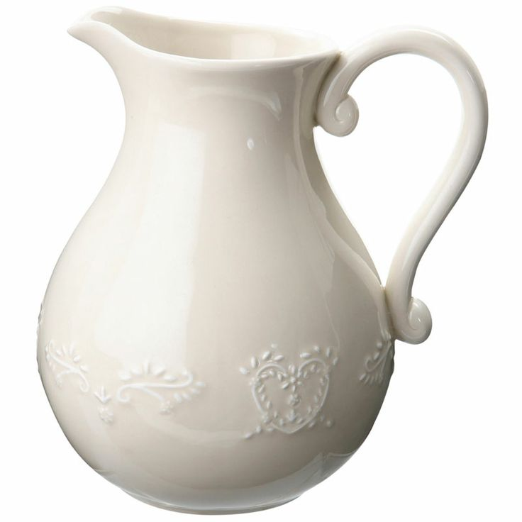 Ivory ceramic pitcher featuring embossed heart detail.
