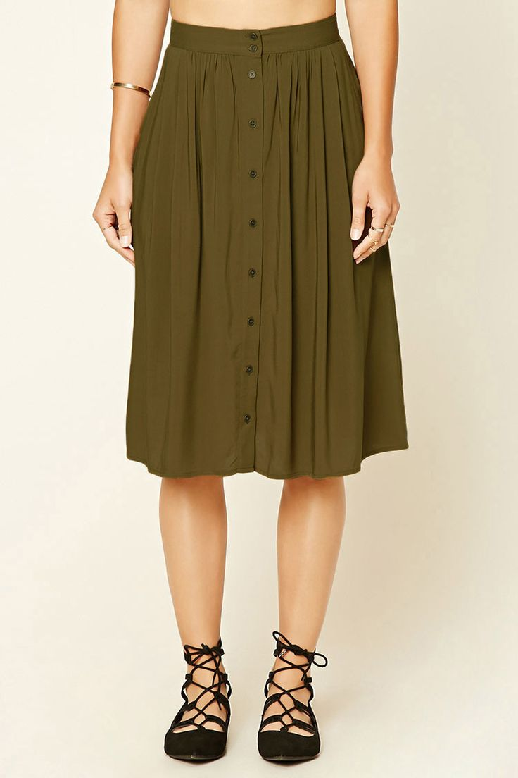 Contemporary - A woven knee-length skirt featuring a button front, two front slanted pockets, and an elasticized back.