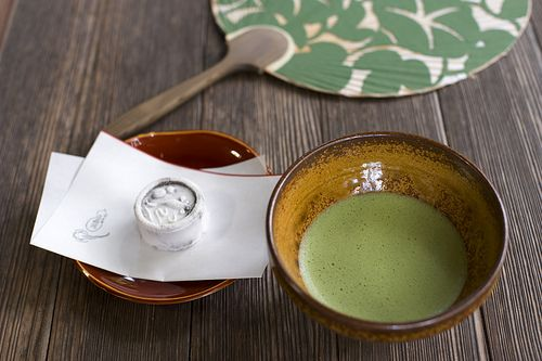 Japanese green tea, sweets and paper fan