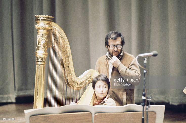 Italian composer Luciano Berio (1925 - 2003) with a harpist, circa 1965.