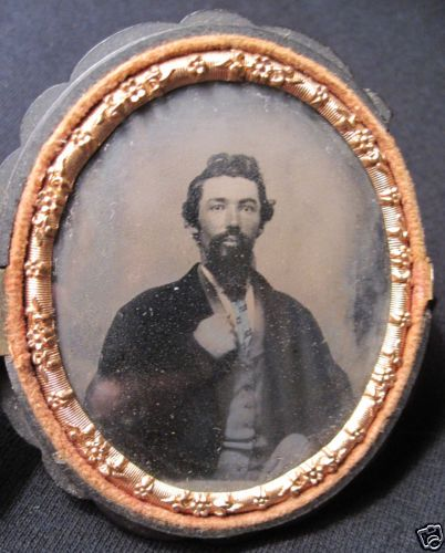 ANTIQUE HANDSOME DARK HAIRED MAN BLUE TIE GOLD ? TOOTH OVAL CASE TINTYPE PHOTO