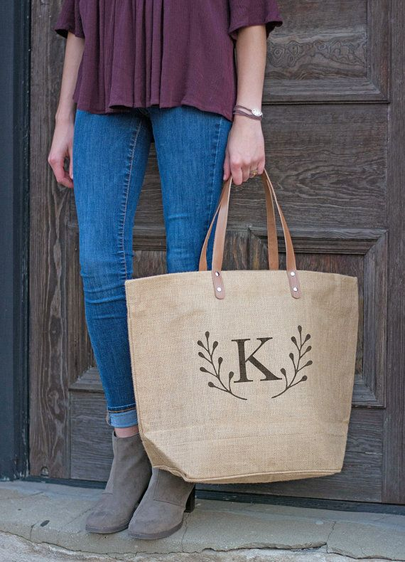 Save 10% and get free shipping on this set of rustic, uniquely personalized bridesmaids bags with code PINTERESTBRIDE. Burlap exterior, fully laminated interior, zippered closure, interior zippered dangling pocket, sturdy vegan leather handles, and a solid, square base so that it stays upright wherever you set it down, just like any well-behaved tote bag should. This bag is a stylish alternative to all your daily toting demands!