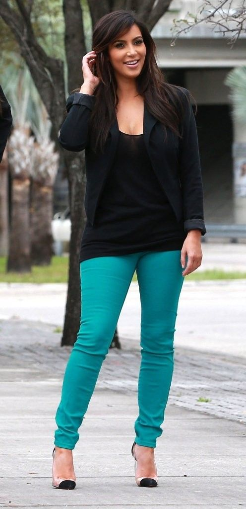 Kim Kardashian Skinny Jeans - Kim brightened up a basic black blazer with shocking teal skinnies.