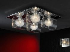 a square ceiling plate with 4 clear glass shades and spherical inner shades with fine filaments inside
