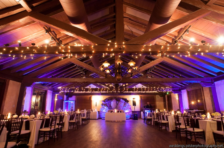 Beautiful ballroom with uplighting and chiavaris to set the mood.