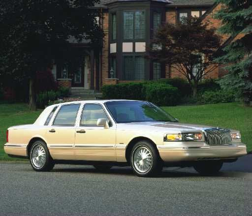 "the 1997 lincoln towncar made some appearances as the ""mafia staff car"".  It's trunk was very roomy"