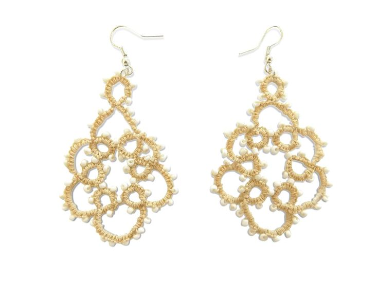 Earrings tatting handmade from cotton thread with a special glue for greater strength in beige color with white beads approximately 2 mm each.