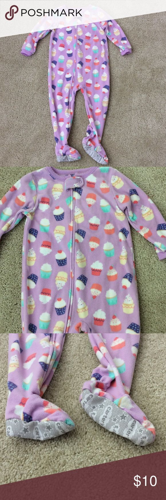 Carter's Footed PJs Carter's Footed PJs. Super cute cupcakes. Zips up the front. Washed but never worn. My daughter did not like the 'feet'. Size 24M. 100% polyester. NWOT. Carter's Pajamas