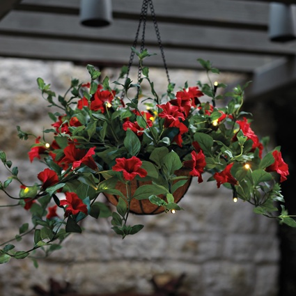 Hanging flower basket with 20 LED lights incorporated into the silk flowers.  lights automatically come on.  Great for those yard areas that are hard to grow flowers with the bonus of night time beauty.  Solutions | Home Organization, Storage & Problem Solving Products
