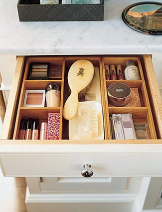 Drawer dividers have a way of instantly making your makeup drawers look organized. Take it a step further by grouping like items together (lipsticks with lipsticks, blushes with blushes, etc).