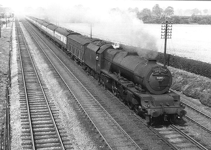 46207: Ex-LMS 8P 4-6-2 Princess Royal class No 46207 Princess Arthur of Connaught is seen in full flight at the head of the Merseyside Express near Cathiron on 8th February 1955