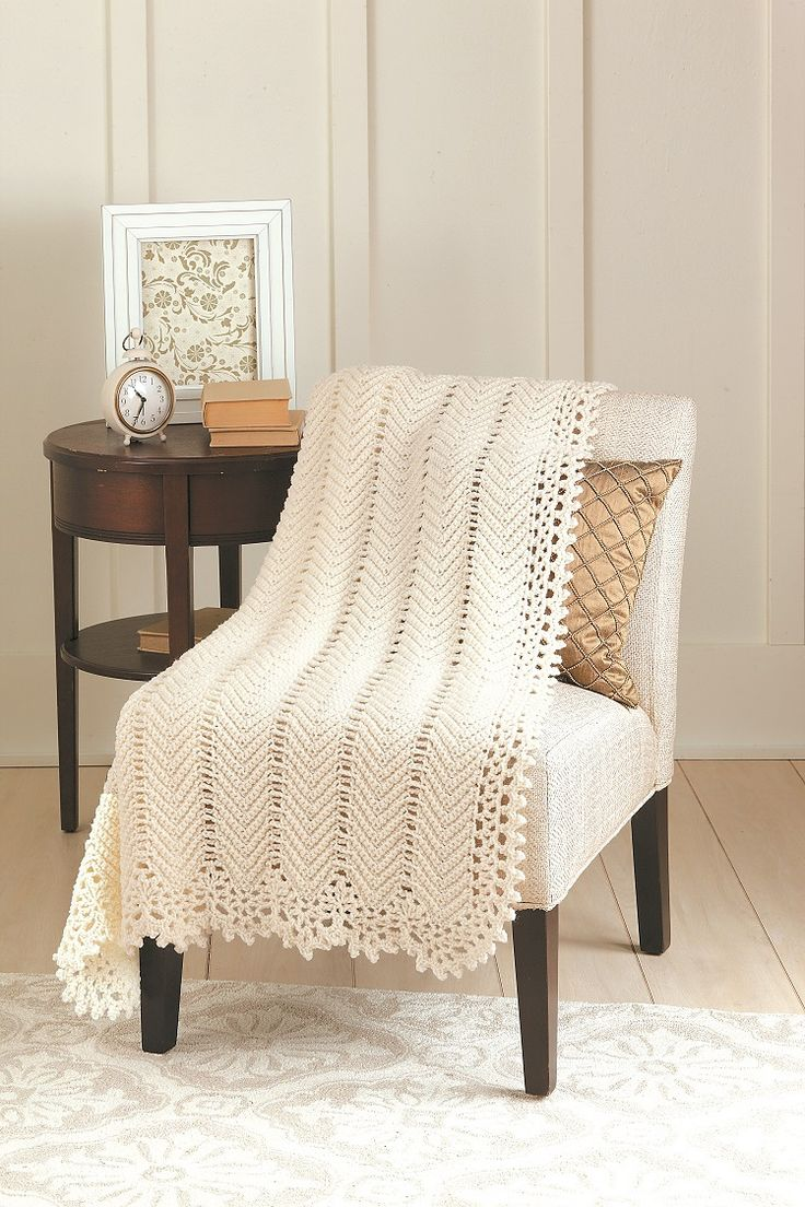 From the pattern: Soft, cream-colored yarn gives this beauty of an afghan its timeless appeal. The body works up quickly in an old-fashioned herringbone pattern, while the lacy edging adds a touch of Victorian style.