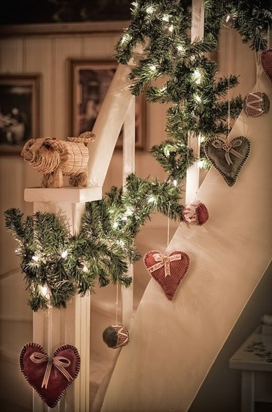 no garland but big red hearts hung with maybe black and white checked ribbon from the banister!