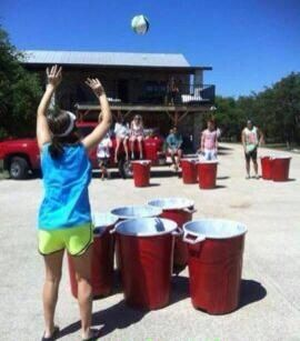 Super beer pong! Trash cans as red solo cups and a volleyball and the ping pong ball