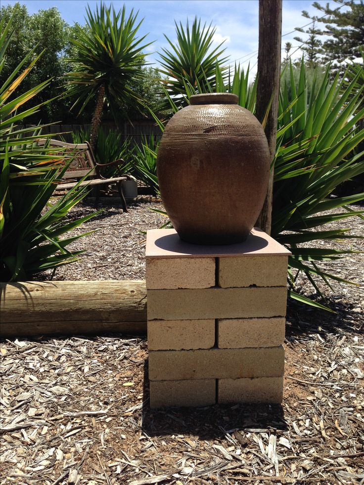 Dry stacked brick plinth. Recycled large bricks.
