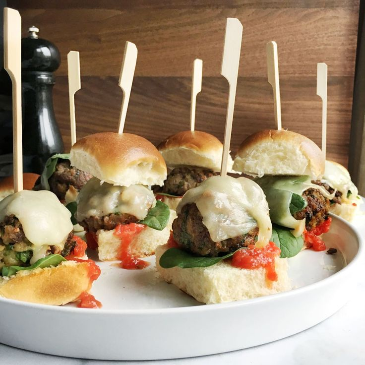 These sandwiches are tiny but mighty: Filled with savory meatballs, gooey mozzarella, and spicy marinara, they're the perfect way to end a week. Get the recipe: Meatball Sliders - Delish.com