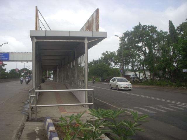 Well developed bus stop for Pune- Mumbai shutter service — at Old Pune-Mumbai Highway