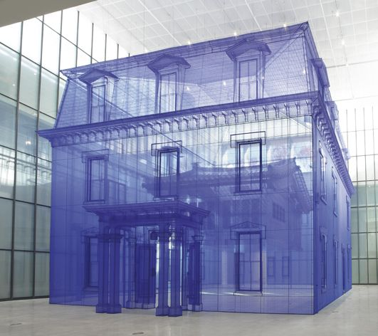 Artist Do Ho Suh created scale replica of two houses he had previously lived in, one inside the other. The work is massive and large enough to walk through.