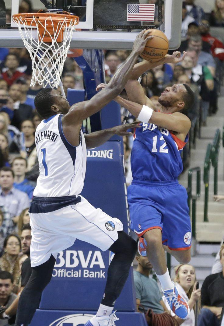 Color game ray otero - Philadelphia Forward Evan Turner Has His Shot Blocked By Dallas Mavericks Center Samuel Dalembert During The Second Half Of An Nba Basketball Game In Dallas