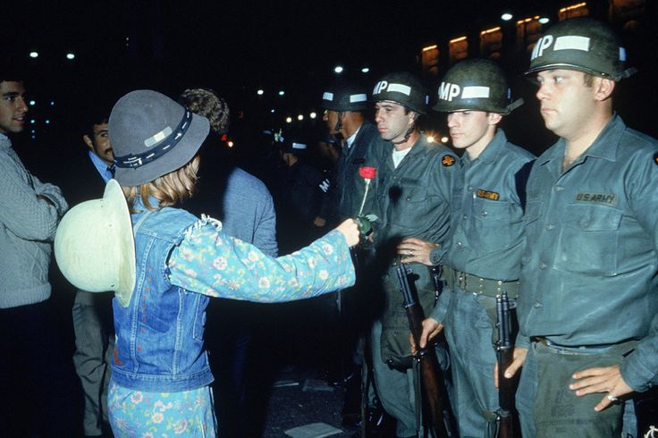 A young woman offers a rose to uniformed military police officers outside the Democratic National Convention in Chicago on Aug. 28, 1968. This Is What US Protests Looked Like In The '60s
