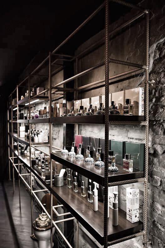 Crime Passionnel niche perfume boutique interior design. Rebar shelfs, raw walls. Nishane Istanbul, Sauf, Naomi Goodsir, Nasomatto, Orto Parisi, Amouage, Puredistance, Unum, LM Parfums, Jovoy Paris, Parfum d'Empire.