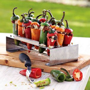 Cooked on the grill in a roaster, stuffed jalapeño peppers emerge with a wonderful fire-roasted flavor.