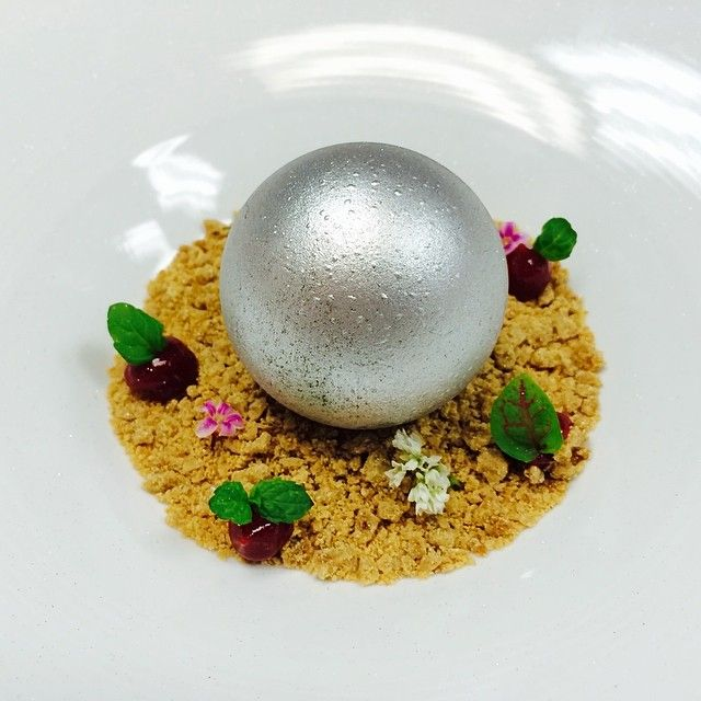 """Pearl of Qatar"" White chocolate rose water pudding , apricot jam, raspberry, spiced crumble"